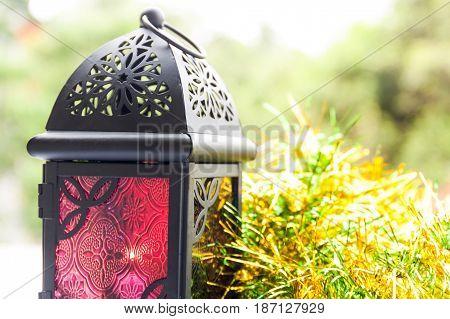 Red Arabic lantern in natural background. Ramadan, Eid concept