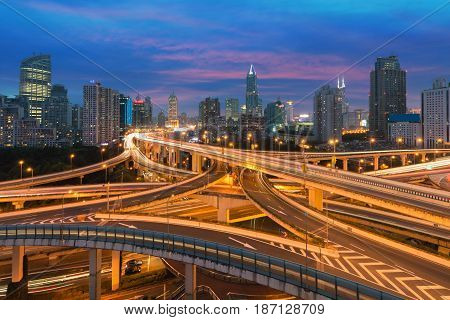 Beautiful Shanghai city with interchange overpass at nightfall in Shanghai China.