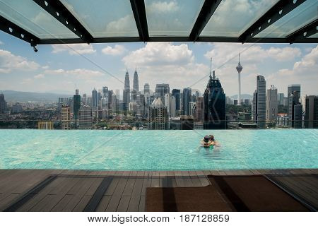Swimming pool on roof top with beautiful city view Kuala lumpur Malaysia.