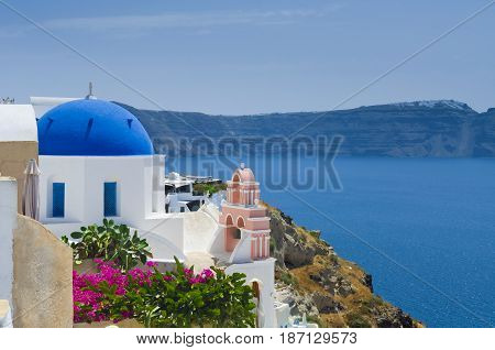Picturesque image of Oia village blue dome on Santorini island