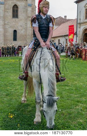 ALBA IULIA ROMANIA - APRIL 29 2017: Roman commandant soldier in battle costume inspect the troops on a horse. APULUM ROMAN FESTIVAL organized by the City Hall.