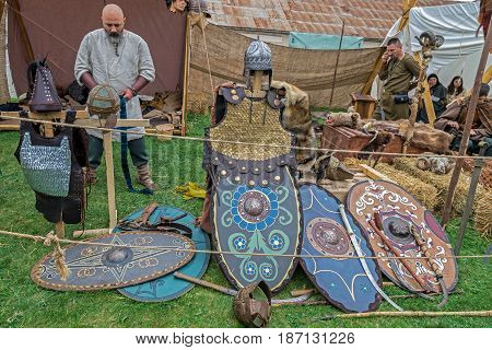 ALBA IULIA ROMANIA - APRIL 29 2017: Dacian soldiers simulate weapons manufacturing in a specific camp.APULUM ROMAN FESTIVAL organized by the City Hall.