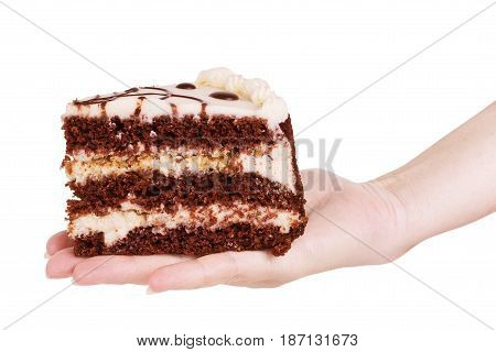 Woman's hands picks chocolate brownie isolated on white background
