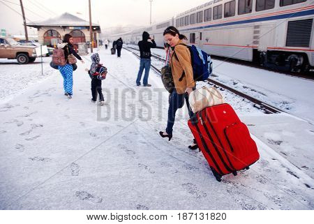 KLAMATH FALLS, OREGON, USA - February 25, 2012: Passengers disembark from an Amtrak train in snowy weather