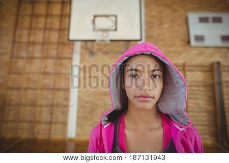 Portrait of high school girl standing in the court