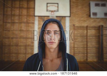 Portrait of high school boy standing in the court
