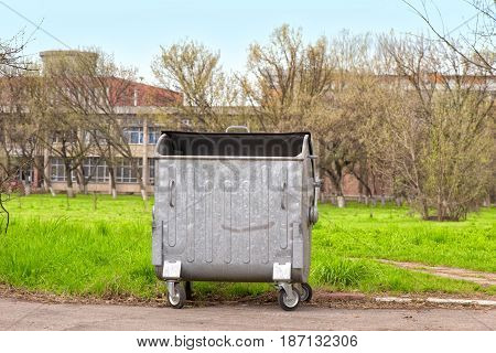 Metallic container for garbage disposal in the park