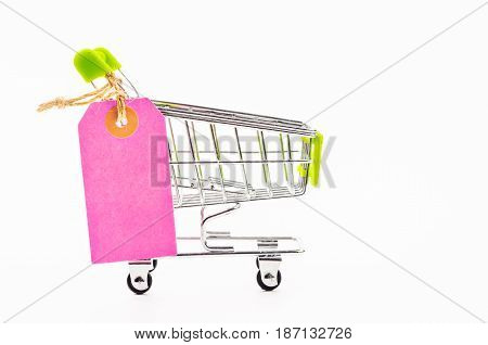 Blank pink paper price tag with shopping cart isolated on white background