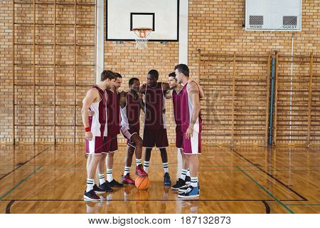 Basketball player interacting with each other in the court