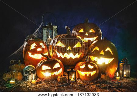 Halloween pumpkin head jack lantern with burning candles