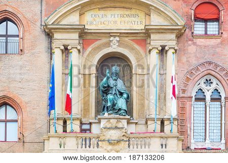 Italy Bologna the statue of Pope Gregorio XIII over the main entrance of the D'Accursio Palace (city hal l) In Maggiore