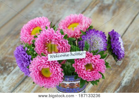 Welcome home card with colorful daisy bouquet