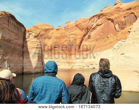 Tourists are visiting the Powell lake and its canyon