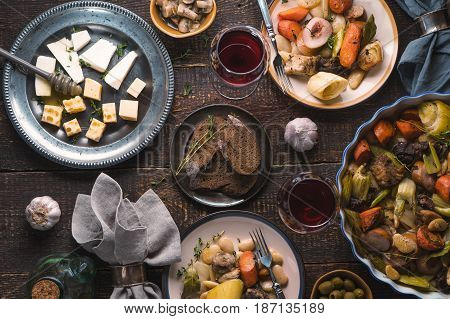 Feast with kasul, cheese, bread, olives and wine horizontal