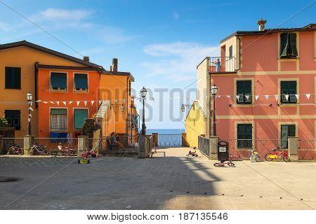Riomaggiore Village With View Of Blue Sea, Cinque Terre, Italy.