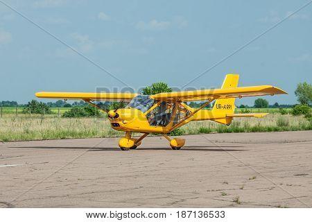 Zhitomir Ukraine - June 17 2011: Aeroprakt A-22 ultralight plane taking off from runway on a sunny day