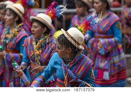 ORURO, BOLIVIA - FEBRUARY 26, 2017: Traditional folk dancers in ornate costumes performing as they parade through the mining city of Oruro on the Altiplano of Bolivia during the annual carnival.