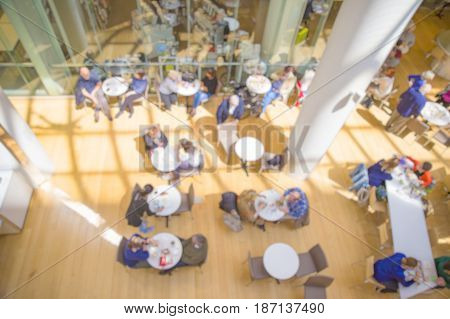 blurred background of food court in the mall. lunch at shopping center, top view