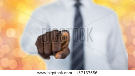 Digital composite of Midsection of businessman pointing over bokeh