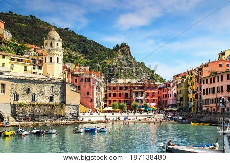 Vernazza village with many people on the beach Cinque Terre Italy.