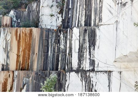 Marble wall in the quarry in the Apennines near Carrara Italy.
