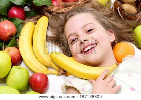 Cute Baby Girl Laying With Colorful Fruits