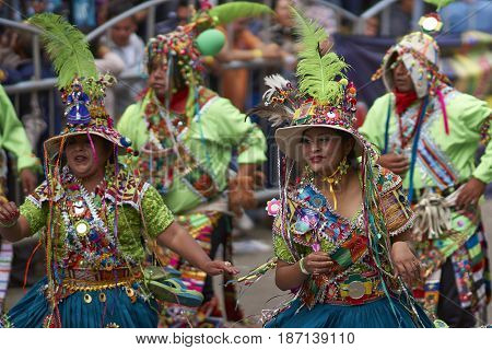 ORURO, BOLIVIA - FEBRUARY 26, 2017: Tinkus dance group in ornate costumes performing as they parade through the mining city of Oruro on the Altiplano of Bolivia during the annual carnival.