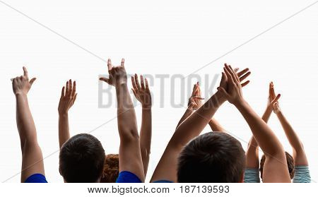 The hands of fans during a concert. Studio shot on white background