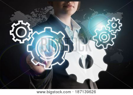 Business woman touching mechanical gear high quality and high resolution studio shoot