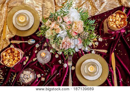 Served Table With Bouquet And Candles