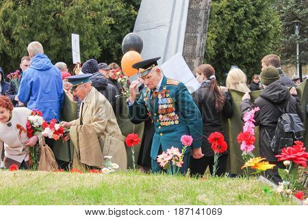Kirishi, Russia - 9 May, Give honor to the fallen soldiers, 9 May, 2017. Laying wreaths and flowers in memory of the fallen at the Eternal Flame.