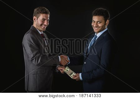 Businessman Giving Money And Bribing Business Partner Isolated On Black, Businesspeople Shaking Hand
