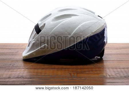 A Bicycle Helmet on a Wooden Background
