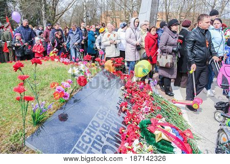 Kirishi, Russia - 9 May, The flow of people from mass graves, 9 May, 2017. Laying wreaths and flowers in memory of the fallen at the Eternal Flame.