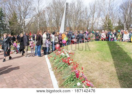 Kirishi, Russia - 9 May, People on Victory Day on communal graves, 9 May, 2017. Laying wreaths and flowers in memory of the fallen at the Eternal Flame.