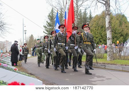 Kirishi, Russia - 9 May, A flag group with flags on the track, 9 May, 2017. Laying wreaths and flowers in memory of the fallen at the Eternal Flame.