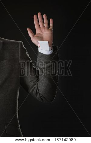 Partial View Of Businessman With Joker Card In Sleeve Isolated On Black