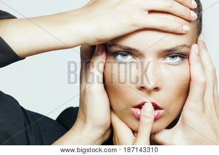 Many Hands Touching Adorable Face Of Pretty Woman