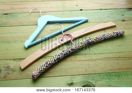 Row of Clothes Hangers on Wooden Background