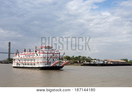 Savannah GA - March 27 2017: The Georgia Queen is an 1800s style paddlewheel riverboat and tourist attraction in historic Savannah Georgia. It can accommodate up to 1000 passengers and is the newest member of the Savannah Riverboat Cruise fleet.