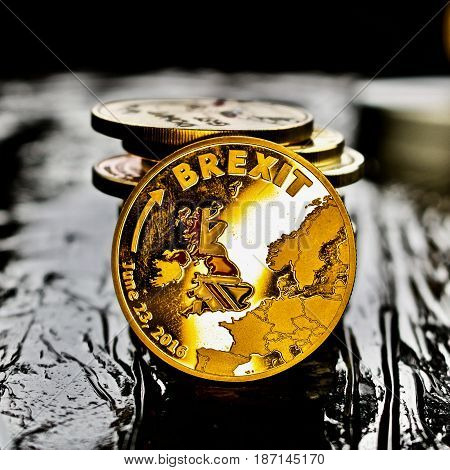Gold brexit coin. United Kingdom leaving europe