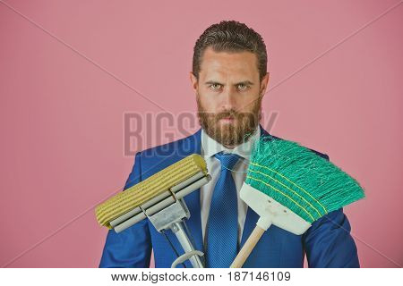 Businessman Or Man With Serious Face, Broom In Business Outfit