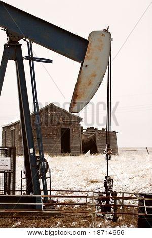 Pump jack near abandoned homestead scenic beauty