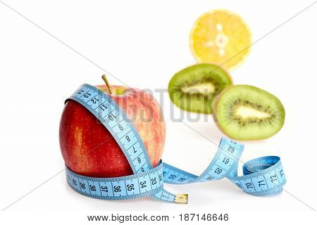 Apple Fruit Wrapped In Measuring Tape With Other Tropical Fruit
