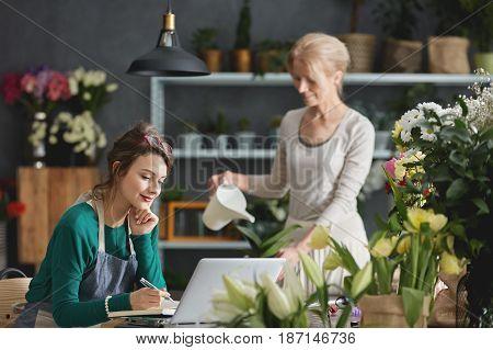 Florist Using Computer At Work