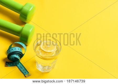 Overweight With Dumbbells, Measuring Tape And Water With Lemon
