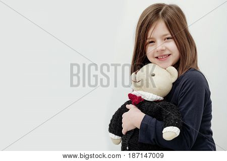 Happy Cute Girl Hugging Cute, Teddy Bear Toy