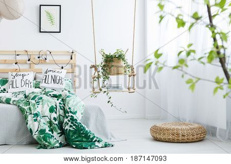 White Bedroom With Rattan Pouf