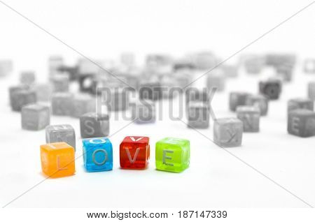Love word isolated on white background colourful small cubes.Declaration of love concept.