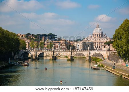 View of Vittorio Emanuele bridge on the Tiber river and St. Peter's Basilica in Vatican Italy